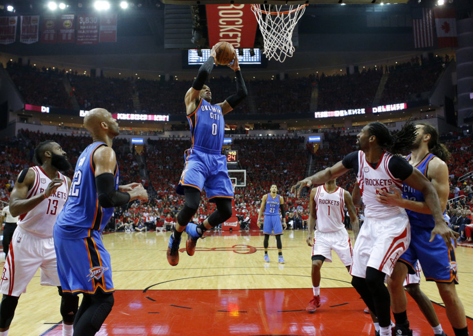 Photo - Oklahoma City's Russell Westbrook (0) goes up for a basket during Game 5 in the first round of the NBA playoffs between the Oklahoma City Thunder and the Houston Rockets in Houston, Texas,  Tuesday, April 25, 2017.  Houston won 105-99. Photo by Sarah Phipps, The Oklahoman
