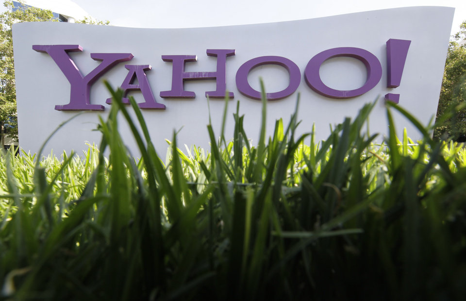 FILE - In this May 20, 2012 file photo, a Yahoo sign stands outside the company\'s offices in Santa Clara, Calif. Yahoo turned in another lackluster performance in the second quarter announce the company on Tuesday, July 17, 2012. The results underscore the challenges facing Yahoo\'s newly hired CEO Marissa Mayer as she tries to turn around the Internet company after a 13-year career as a top Google executive. (AP Photo/Paul Sakuma, File)