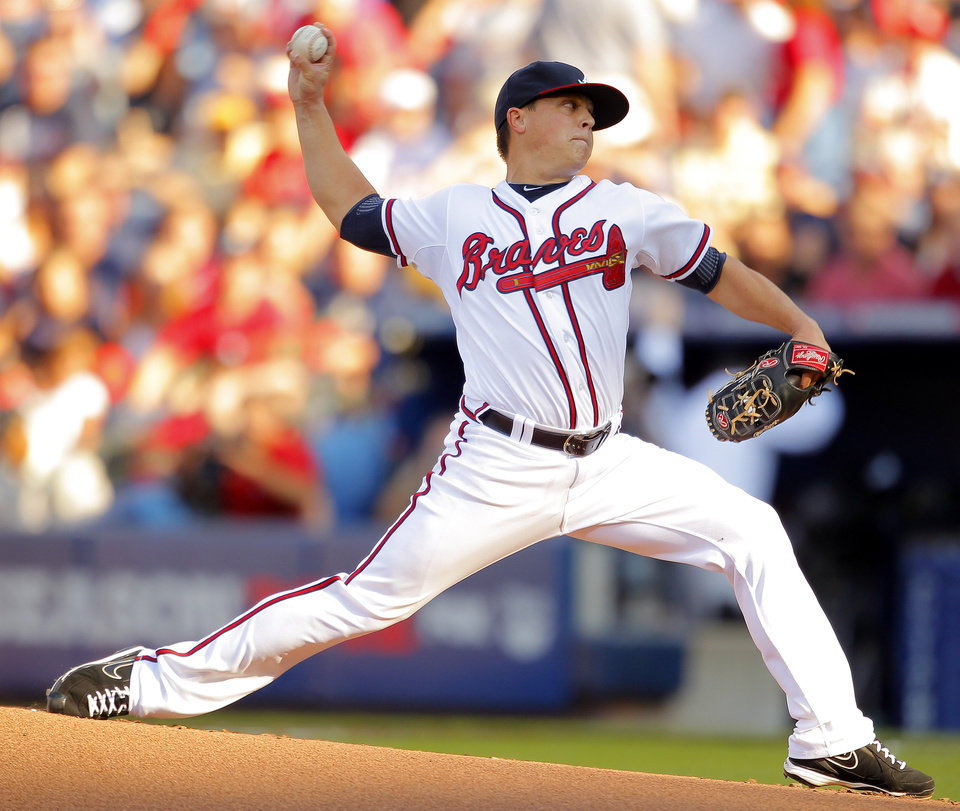 Photo -   Atlanta Braves pitcher Kris Medlen works during the first inning of the National League wild card playoff baseball game against the St. Louis Cardinals, Friday, Oct. 5, 2012, in Atlanta. (AP Photo/Todd Kirkland)