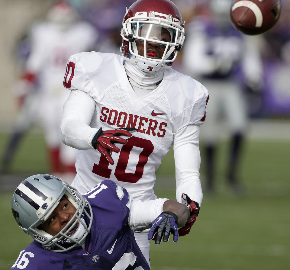 Oklahoma defensive back Quentin Hayes (10) breaks up a pass intended for Kansas State wide receiver Tyler Lockett (16) the first half of an NCAA college football game Saturday, Nov. 23, 2013 in Manhattan, Kan. (AP Photo/Charlie Riedel)