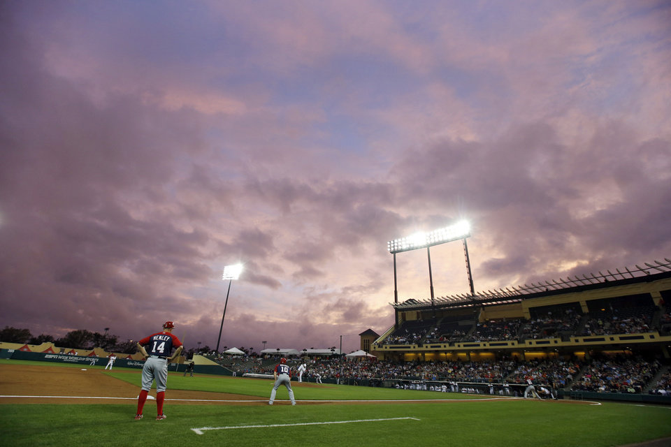 Photo - The sun sets beyond Champion Stadium in the second inning of an exhibition baseball game between the Washington Nationals and the Atlanta Braves, Thursday, March 6, 2014, in Kissimmee, Fla. (AP Photo/Alex Brandon)