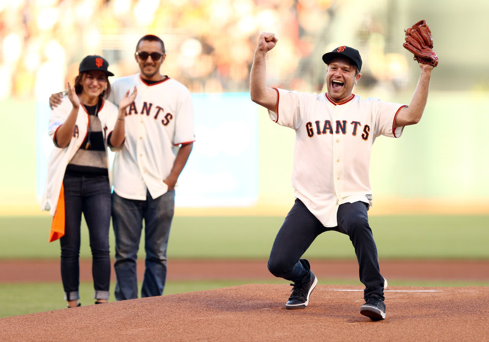 Photo - Zak Williams, son of Robin Williams reacts after throwing out the ceremonial first pitch before Game 5 of baseball's World Series between the Kansas City Royals and the San Francisco Giants Sunday, Oct. 26, 2014, in San Francisco. (AP Photo/Elsa, Pool)