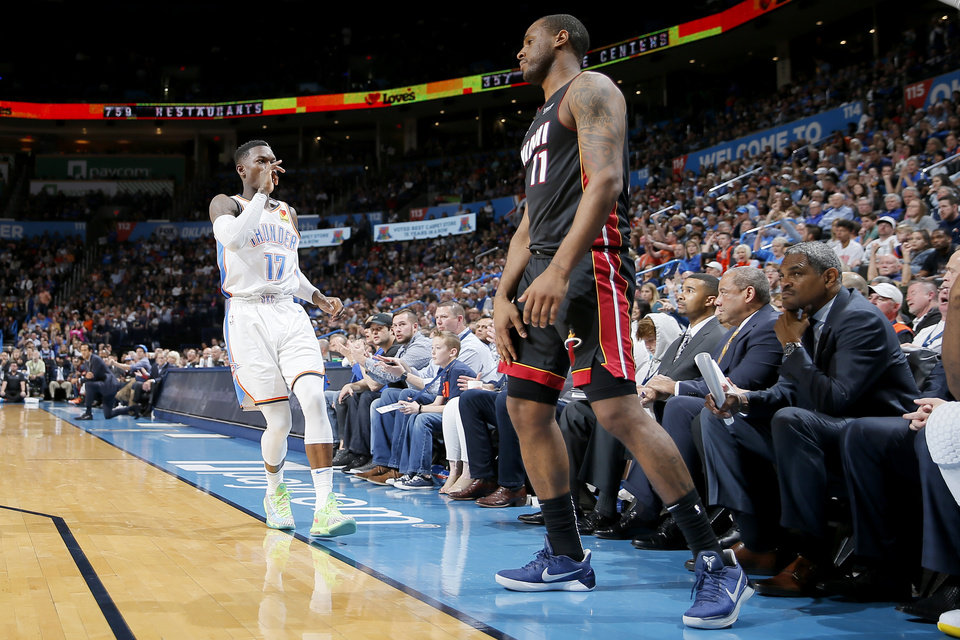 Photo - Oklahoma City's Dennis Schroder (17) celebrates after a 3-pointer beside Miami's Dion Waiters (11) during an NBA basketball game between the Oklahoma City Thunder and the Miami Heat at Chesapeake Energy Arena in Oklahoma City, Monday, March 18, 2019. Photo by Bryan Terry, The Oklahoman