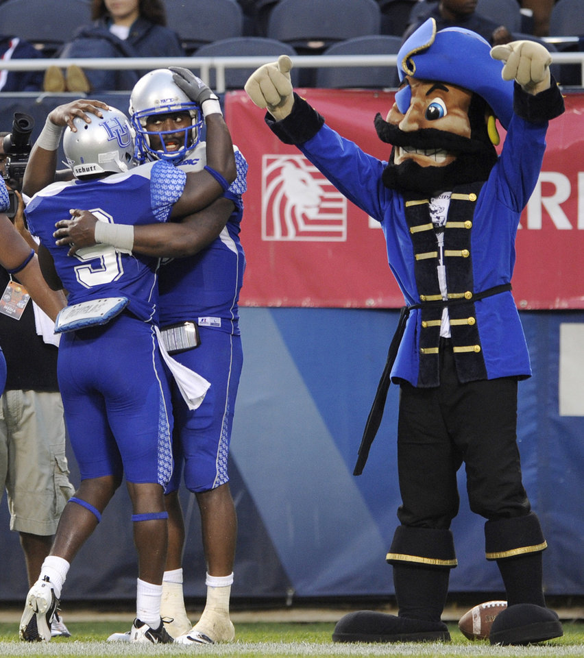 Hampton quarterback David Legree right, celebrates with teammate Isiah Thomas after Legree scored a rushing touchdown during the third quarter of a college football game against Alabama A&M in Chicago, Saturday, Sept. 3, 2011. Hampton won 21-20. (AP Photo/Paul Beaty)