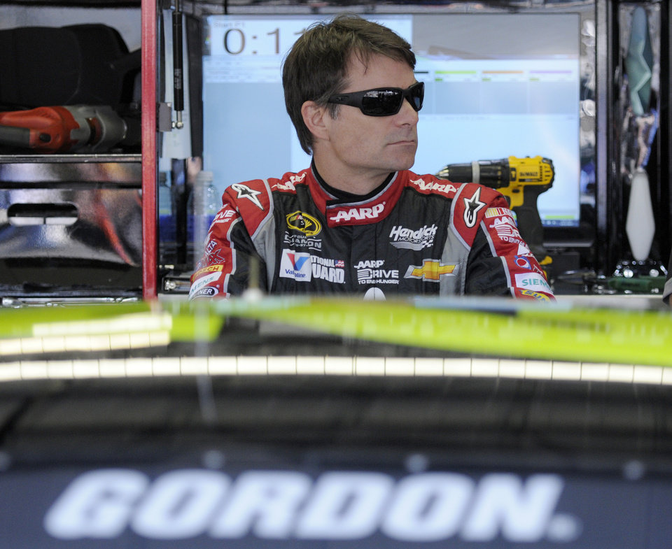 Photo - Jeff Gordon waits by his car before a NASCAR Sprint Cup series auto race practice at Darlington Speedway in Darlington, S.C., Friday, April 11, 2014. (AP Photo/Mike McCarn)