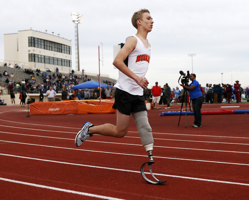 Norman's Patrick Ahearn runs the 400-meter dash with his prosthetic leg during a track meet at Putnam City High School in Oklahoma City, Friday, April 5, 2013. Ahearn lost part of his leg in a personal watercraft accident last year. Photo by Nate Billings, The Oklahoman