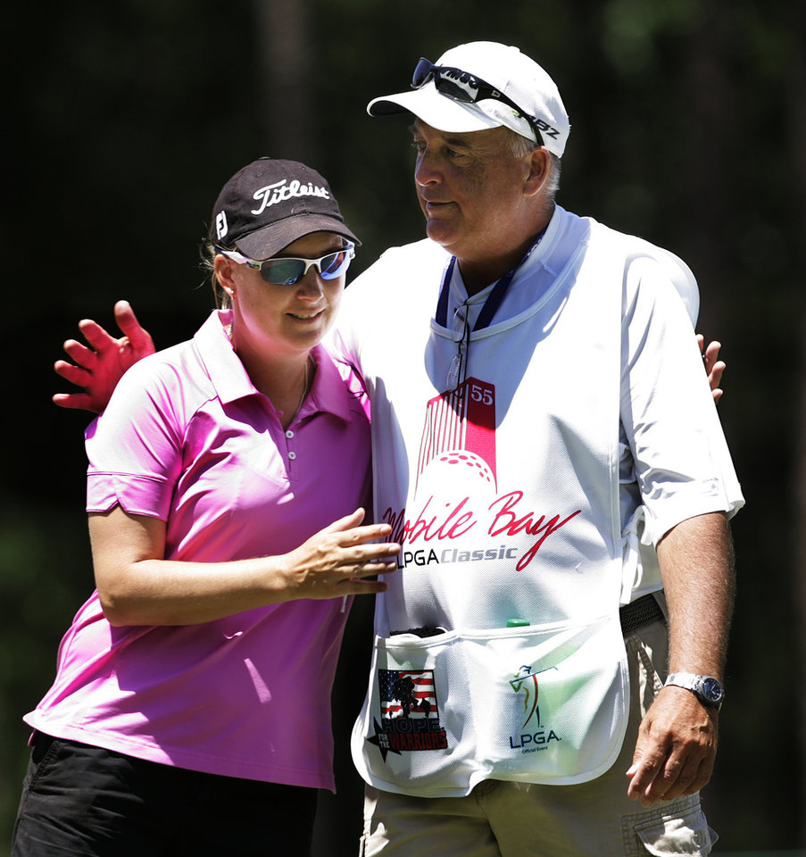 Photo -   Lindsey Wright, left, is greeted by her caddie after finishing the first round of the Mobile Bay LPGA Classic golf tournament, Thursday April 26, 2012, in Mobile, Ala. (AP Photo/ Press-Register, Victor Calhoun) MAGS OUT