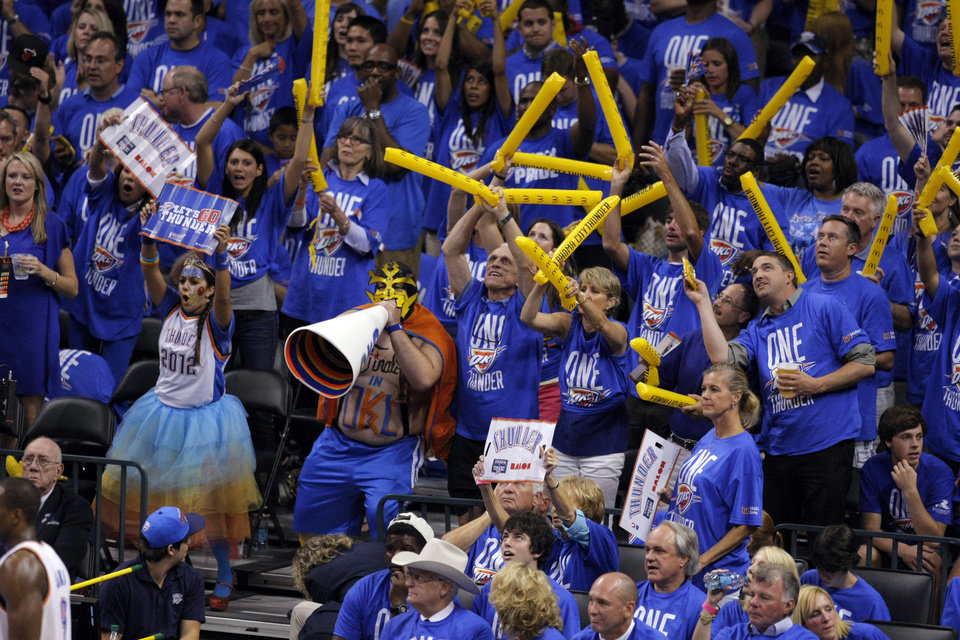 Fans celebrate during Game 1 of the NBA Finals between the Oklahoma City Thunder and the Miami Heat at Chesapeake Energy Arena in Oklahoma City, Tuesday, June 12, 2012. Photo by Sarah Phipps, The Oklahoman