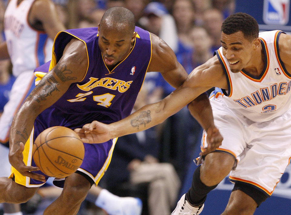 Oklahoma City's Thabo Sefolosha (2) defends Los Angeles' Kobe Bryant (24) during Game 2 in the second round of the NBA playoffs between the Oklahoma City Thunder and L.A. Lakers at Chesapeake Energy Arena in Oklahoma City, Wednesday, May 16, 2012. Photo by Bryan Terry, The Oklahoman