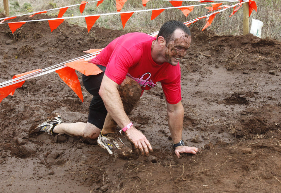 Nick Hamar comes out of a mud pit in the Juggernaut mud run at Mitch Park, in Edmond, OK, Saturday, September 29, 2012. The Juggernaut is part of a national mud run series to raise money for Susan G. Komen for the Cure. By Paul Hellstern, The Oklahoman