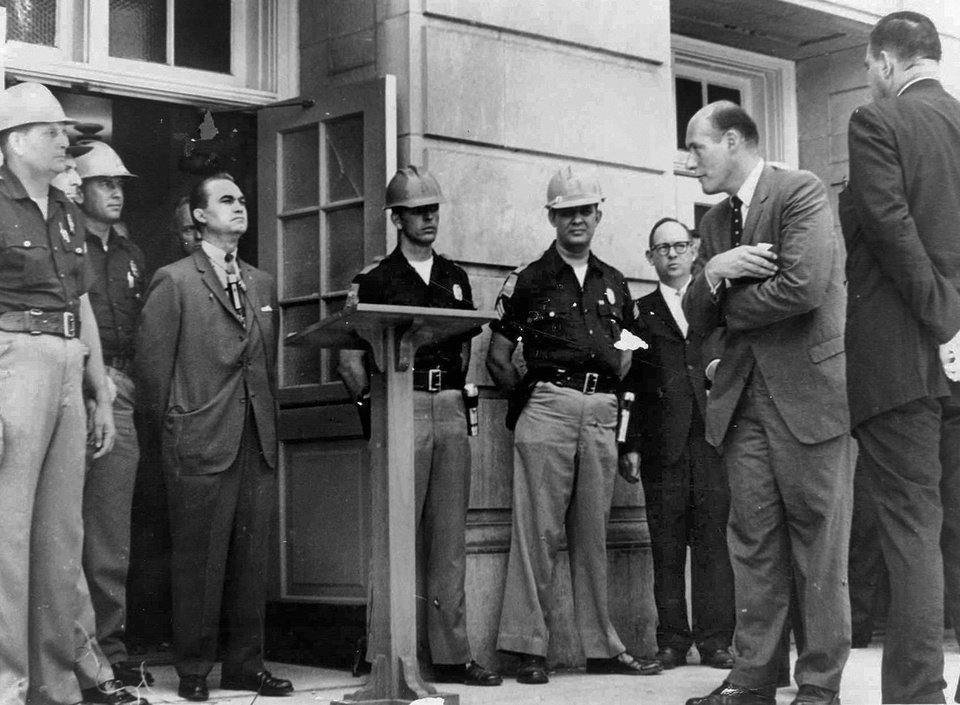 FILE - In this June 11, 1963 file photo, U.S. Deputy Attorney General Nicholas Katzenbach, second right, confronts Alabama Gov. George C. Wallace, standing in front of a door to keep blacks from enrolling at the University of Alabama in Tuscaloosa, Ala. (AP Photo/Tuscaloosa News, Calvin Hannah, File)