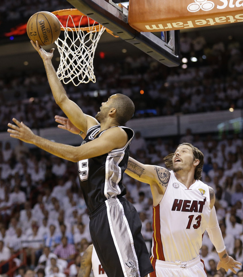 Photo - San Antonio Spurs' Tony Parker (9) shoots against the Miami Heat's Mike Miller (13) during the first half in Game 7 of the NBA basketball championships, Thursday, June 20, 2013, in Miami. (AP Photo/Lynne Sladky)