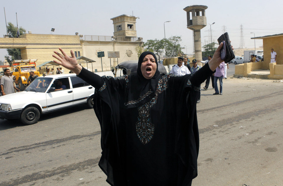 Photo - A supporter of Egypt's deposed autocrat Hosni Mubarak chants slogans in front of Torah prison where he is held, in Cairo, Egypt, Thursday, Aug. 22, 2013. Mubarak is expected to be freed from prison and placed under house arrest on Thursday after being ordered released the previous day, following more than two years in detention. (AP Photo/Amr Nabil)