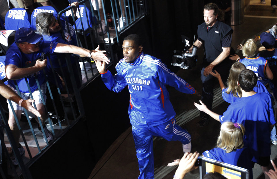 Oklahoma City's Kevin Durant (35) greets fans as he enters the arena before game 3 of the Western Conference Finals of the NBA basketball playoffs between the Dallas Mavericks and the Oklahoma City Thunder at the OKC Arena in downtown Oklahoma City, Saturday, May 21, 2011. Photo by Nate Billings, The Oklahoman