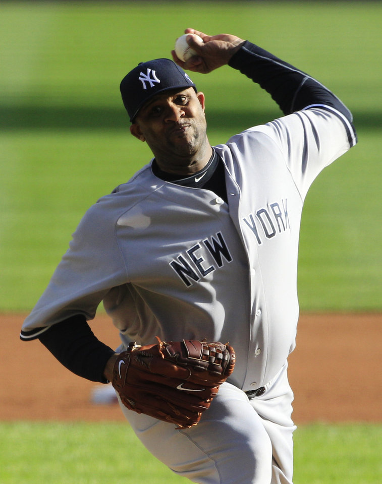 Photo -   New York Yankees' CC Sabathia throws in the first inning during Game 4 of the American League championship series against the Detroit Tigers Thursday, Oct. 18, 2012, in Detroit. (AP Photo/Carlos Osorio)