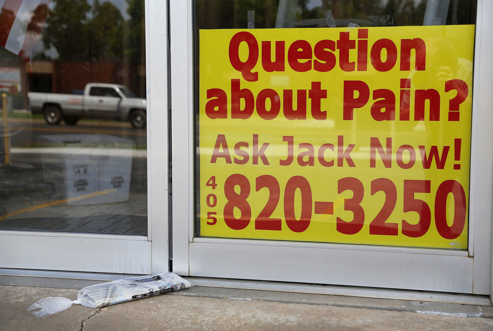 Photo -  Doors were locked and a closed sign was displayed in the front window of Jack's Homeopathic Answer, 4220 NW 23, Monday after the store's owner, Jack McClung, 79, died after a hit-and-run accident Sunday. Police have yet to locate the suspect. Photo by Jim Beckel, The Oklahoman   Jim Beckel -