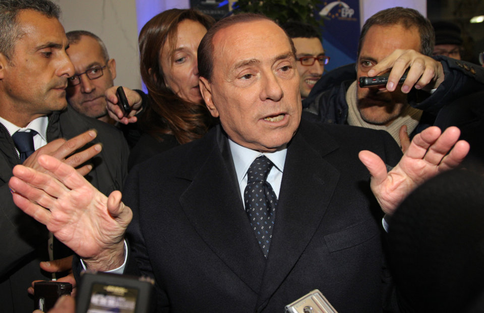 Photo - Italy's EPP party member Silvio Berlusconi talks to the media at the end of the European People's Party summit, ahead of the EU summit in Brussels on Thursday, Dec. 13, 2012. In one whirlwind morning, the European Union nations agreed on the foundation of a fully-fledged banking union and Greece's euro partners approved billions of euros in bailout loans that will prevent the nation from going bankrupt. (AP Photo/Yves Logghe)