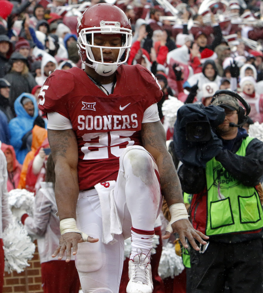 Photo - Oklahoma's Joe Mixon (25) celebrates a touchdown pass during the Bedlam college football game between the Oklahoma Sooners (OU) and the Oklahoma State Cowboys (OSU) at Gaylord Family - Oklahoma Memorial Stadium in Norman, Okla., Saturday, Dec. 3, 2016. Photo by Steve Sisney, The Oklahoman