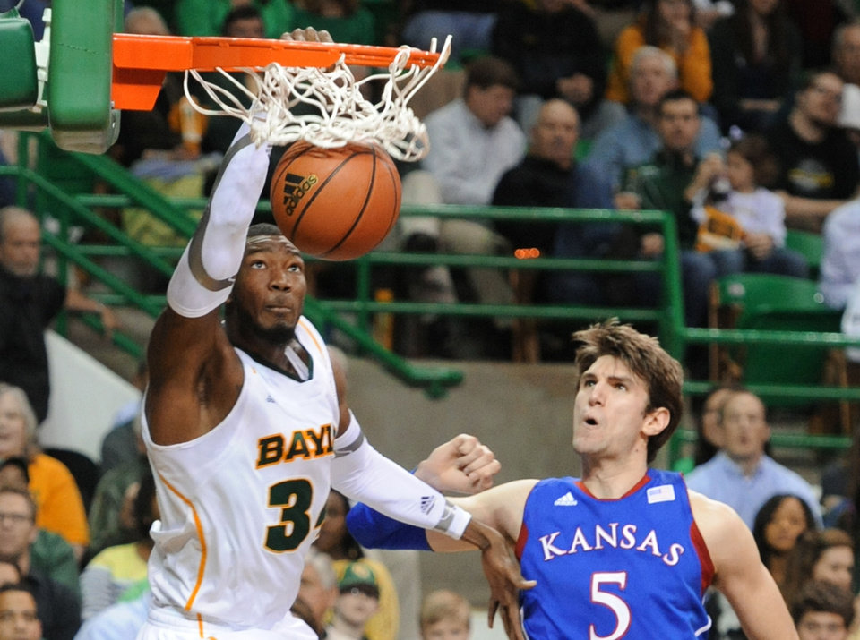 Baylor's Cory Jefferson (34) scores over Kansas Jeff Withey (5) in the second half of an NCAA basketball game on Saturday, March 9,  2013, in Waco, Texas. Baylor won 81-58. (AP Photo/Waco Tribune Herald, Rod Aydelotte) ORG XMIT: TXWAC113