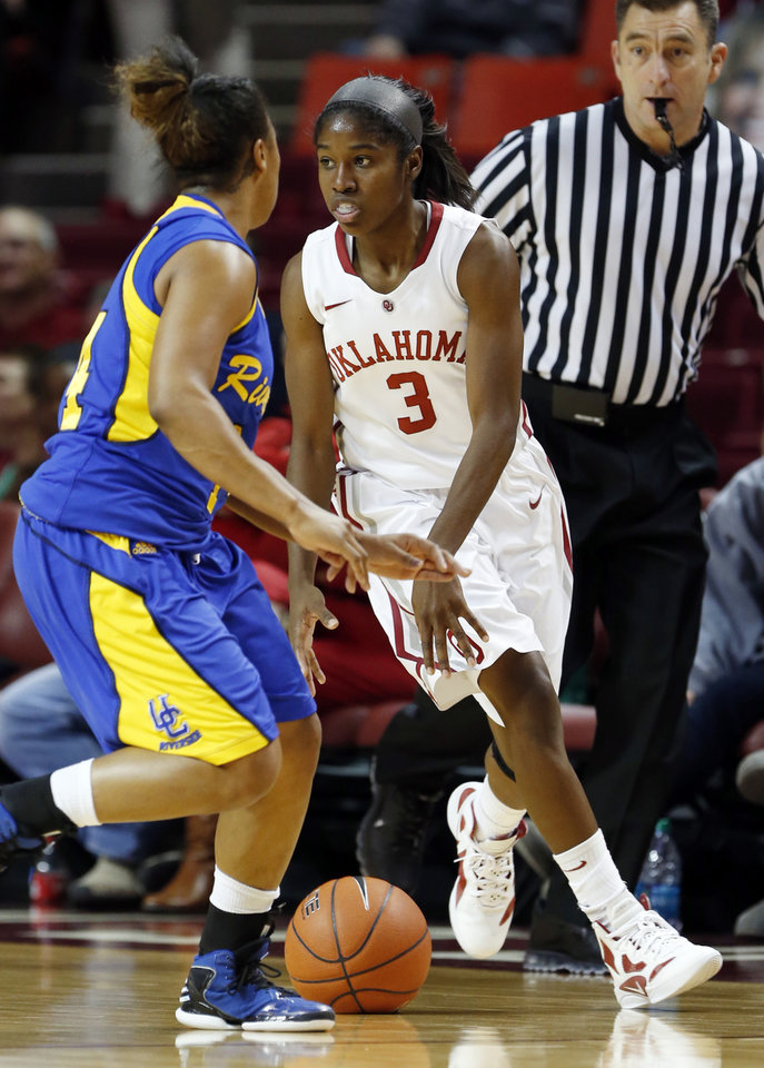 Photo - Oklahoma's Aaryn Ellenberg (3) dribbles in front of Tre'Shonti Nottingham (14) as the University of Oklahoma Sooners (OU) play the Riverside Highlanders in NCAA, women's college basketball at The Lloyd Noble Center on Thursday, Dec. 20, 2012  in Norman, Okla. Photo by Steve Sisney, The Oklahoman