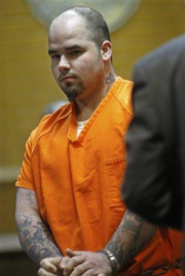 Joshua Durcho, accused of first-degree murder in the strangling deaths of 25-year-old Summer Rust and her four children, is led into the courtroom in El Reno, Okla., Monday, May 24, 2010, for a change of venue hearing. The hearing was postponed for a month. AP Photo