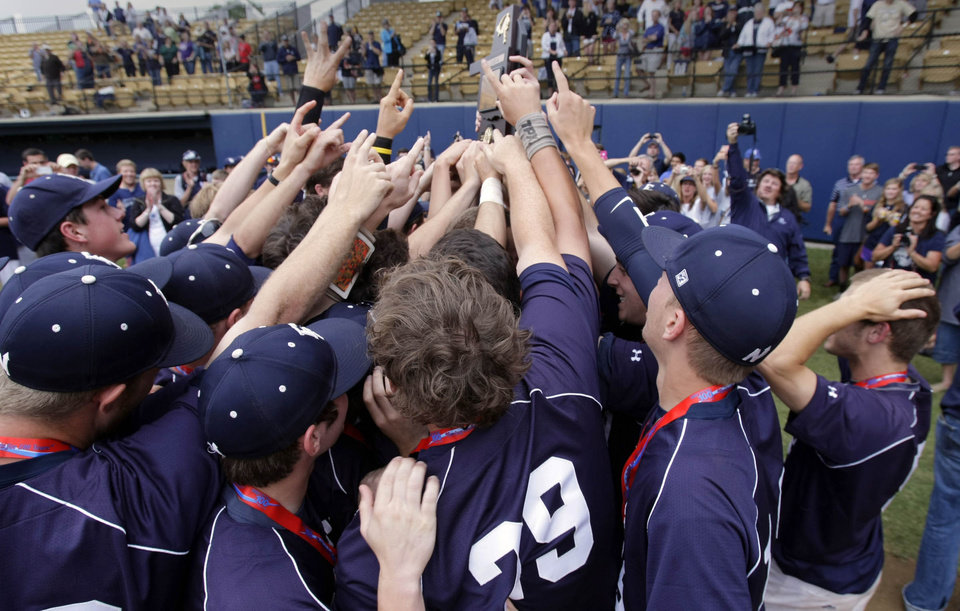 Photo - Edmond North Huskie players hoist the trophy after defeating the Broken Arrow Tigers in the 6A State Baseball Championship at Oral Roberts University in Tulsa, OK, May 12, 2012. MICHAEL WYKE/Tulsa World