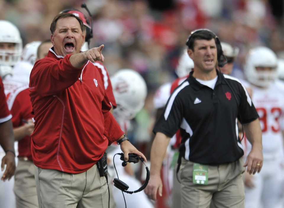 Photo - Indiana head coach Kevin Wilson, left, yells to his team during the first half of an NCAA college football game against Navy, Saturday, Oct. 20, 2012, in Annapolis, Md. Navy won 31-30. (AP Photo/Gail Burton). ORG XMIT: MDGB110
