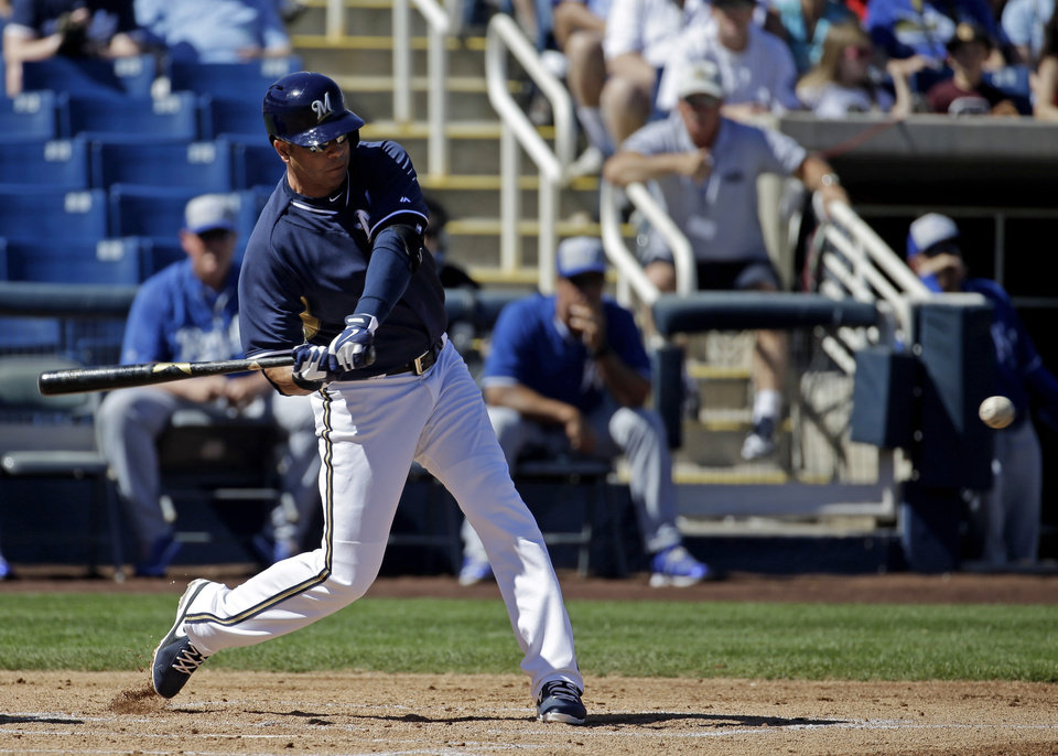 Photo - Milwaukee Brewers' Aramis Ramirez hits a three-run scoring double during the first inning of an exhibition spring training baseball game against the Kansas City Royals Saturday, March 8, 2014, in Phoenix. (AP Photo/Morry Gash)