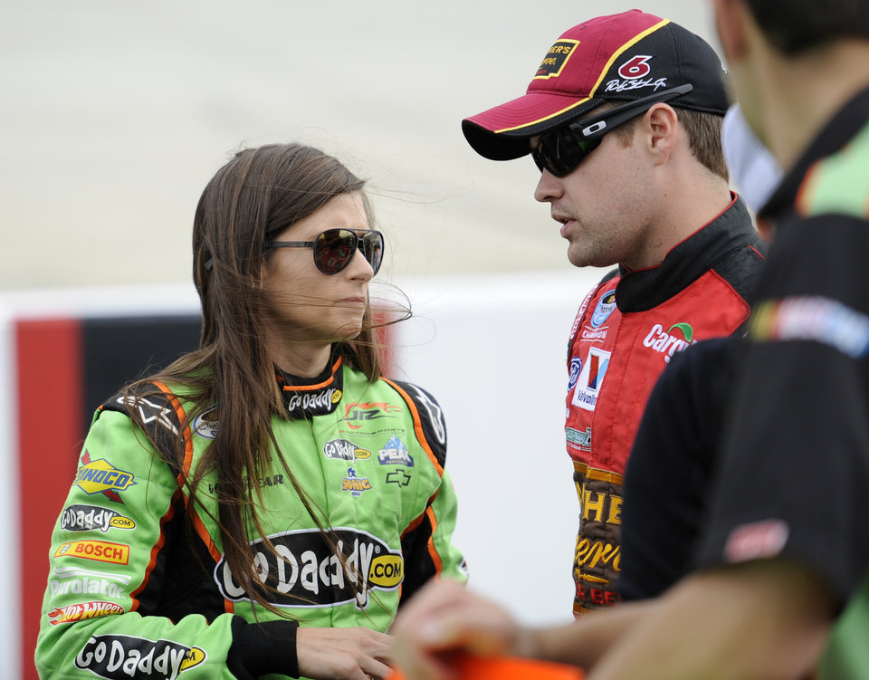 Photo -   Nationwide Series driver Ricky Stenhouse Jr., right, talks with Danica Patrick, left, during qualifying for the OneMain Financial 200 NASCAR Nationwide Series auto race, Saturday, Sept. 29, 2012, in Dover, Del. (AP Photo/Nick Wass)