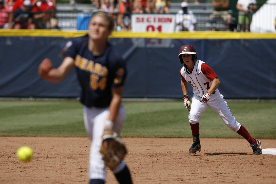 Alabama\'s Jennifer Fenton (7) leads off of second base while California\'s Jolene Henderson (54) pitches during a Women\'s College World Series game between Alabama and California at ASA Hall of Fame Stadium in Oklahoma City, Sunday, June 3, 2012. Photo by Garett Fisbeck, The Oklahoman