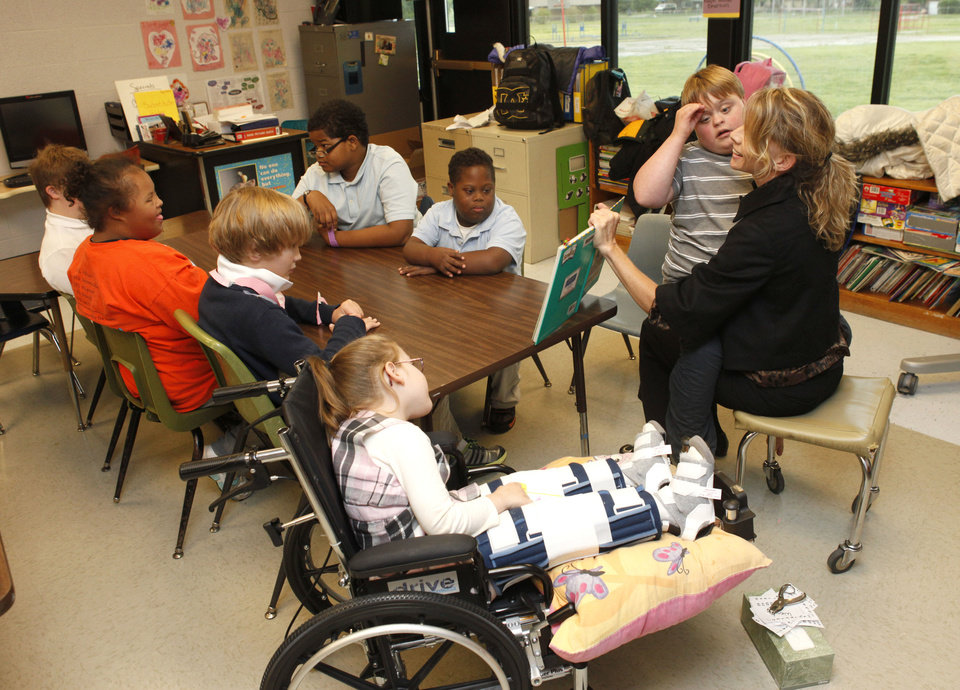 Photo - Special education teacher Angie Absher works with students at Johnson Elementary School. Photo by Paul Hellstern, The Oklahoman  PAUL HELLSTERN