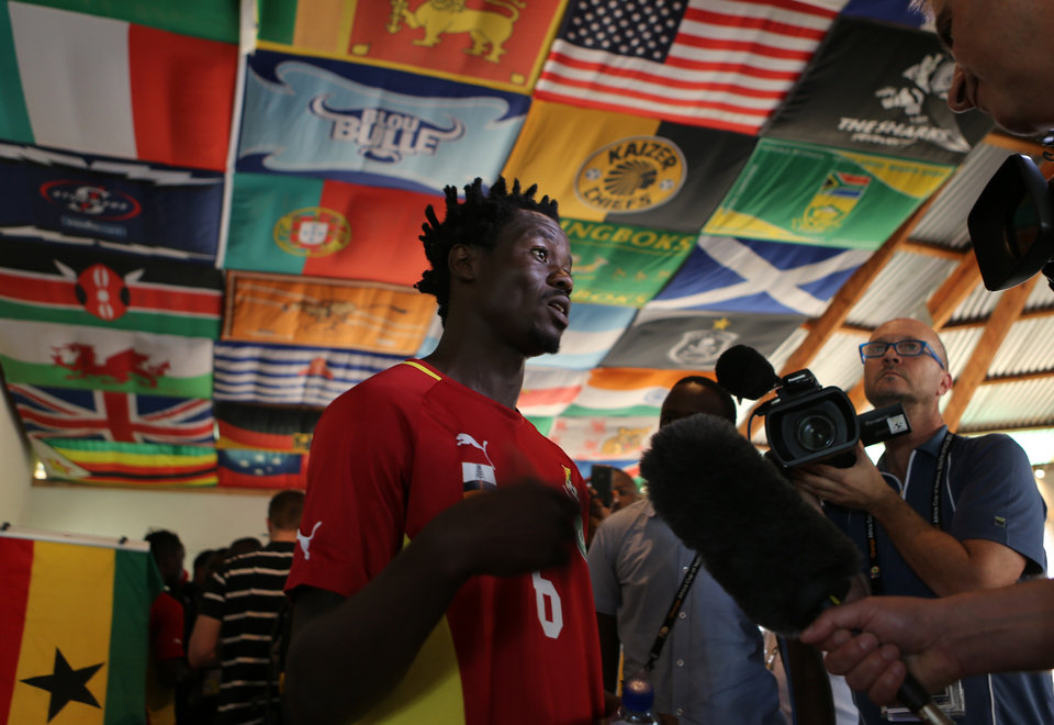 Ghana's Anthony Annan speaks to journalist after their media conference at the team hotel in Nelspruit, South Africa, Tuesday Feb. 5, 2013. Ghana will play their African Cup of Nations semifinal soccer match against Burkina Faso on Wednesday Feb. 6, 2013. (AP Photo/Themba Hadebe)