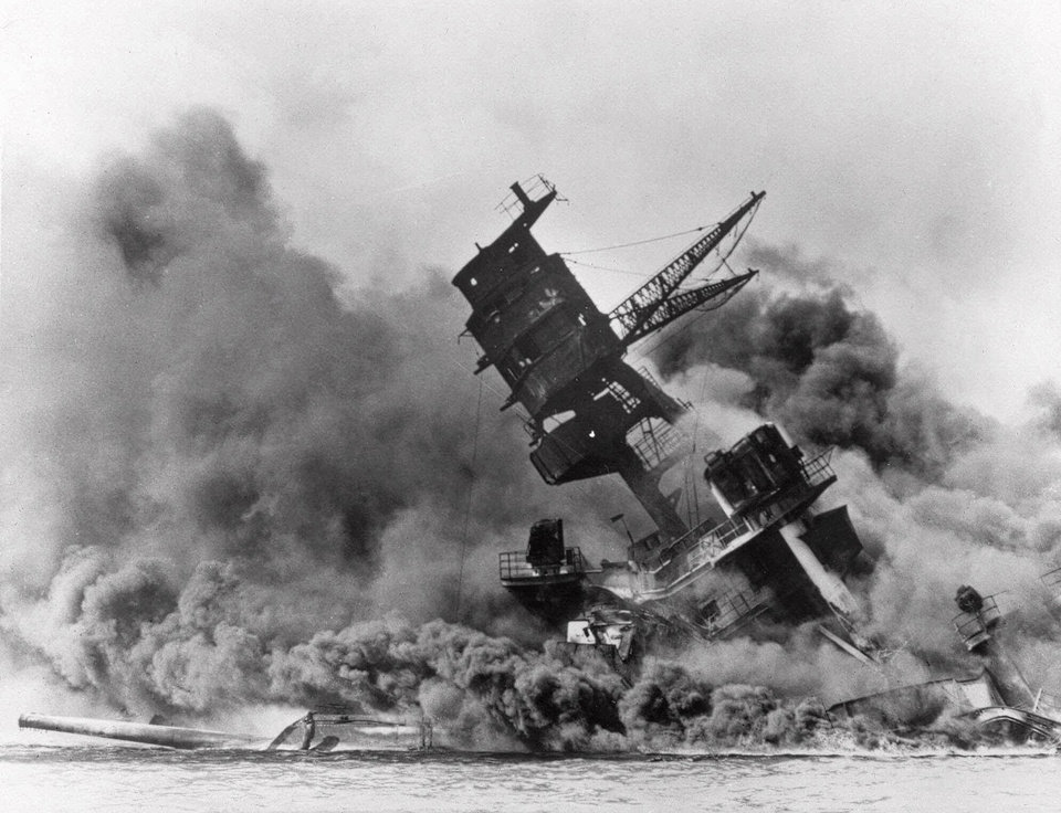 Photo - FILE - In this Dec. 7, 1941 file photo, smoke rises from the battleship USS Arizona as it sinks during a Japanese surprise attack on Pearl Harbor, Hawaii. (AP File Photo)