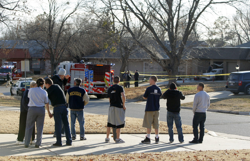A crowd gathers as authorities look over the scene of a car accident and shooting at 601 Whispering Oak Road in Oklahoma City, Tuesday, Jan. 10, 2012. Photo by Bryan Terry, The Oklahoman