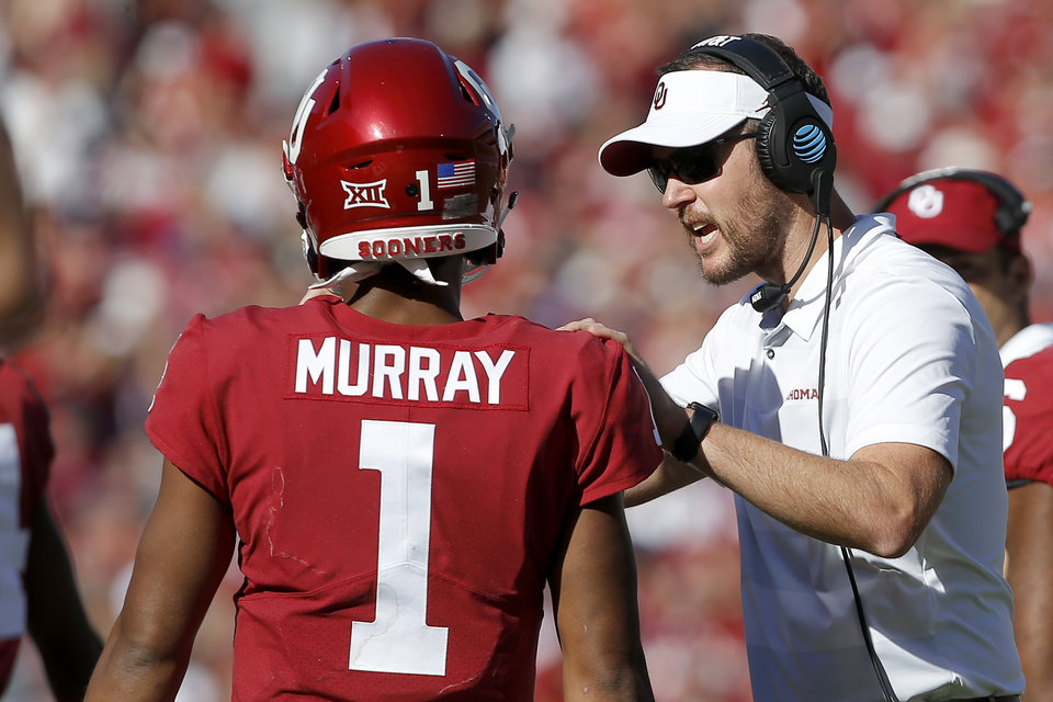 Photo - Oklahoma coach Lincoln Riley talks with Kyler Murray (1) during a college football game between the University of Oklahoma Sooners (OU) and the Kansas State Wildcats at Gaylord Family-Oklahoma Memorial Stadium in Norman, Okla., Saturday, Oct. 27, 2018. Oklahoma won 51-14. Photo by Bryan Terry, The Oklahoman