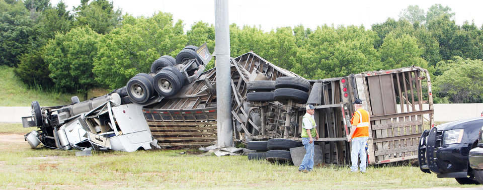Photo - A tractor-trailer loaded with horses overturned Tuesday on the Turner Turnpike at the Interstate 35 exit in Oklahoma City PHOTO BY PAUL B. SOUTHERLAND