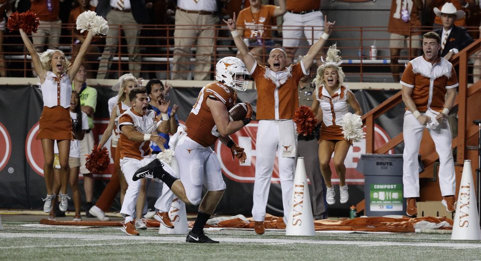 Photo - Texas tight end Cade Brewer (80) scores a touchdown against Oklahoma State during the second half of an NCAA college football game Saturday, Sept. 21, 2019, in Austin, Texas. (AP Photo/Eric Gay)