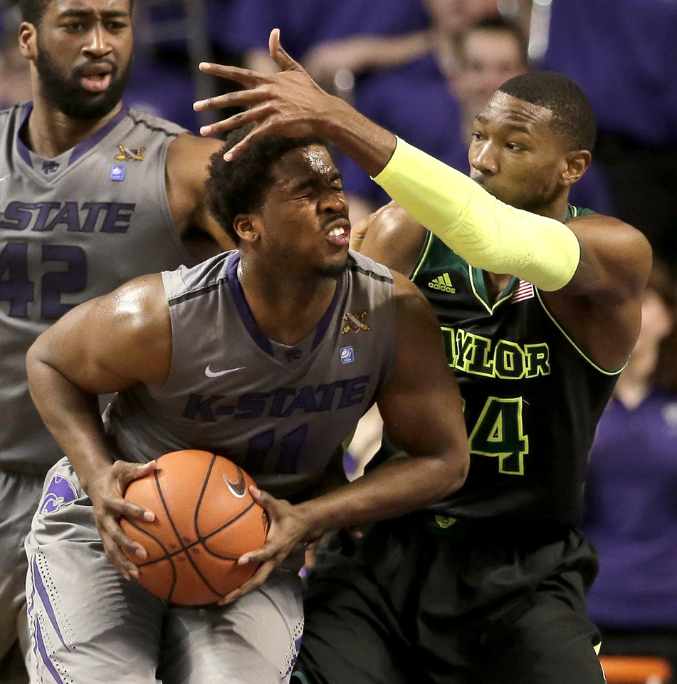 Photo - Kansas State's Nino Williams is pressured by Baylor's Cory Jefferson, right, during the first half of an NCAA college basketball game Saturday, March 8, 2014, in Manhattan, Kan. (AP Photo/Charlie Riedel)