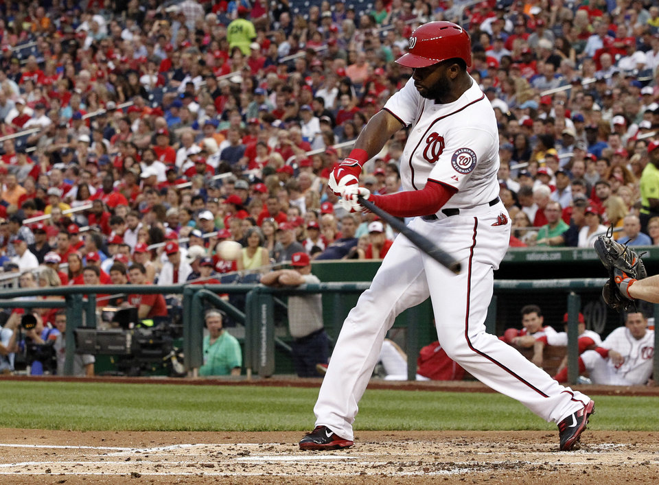 Photo - Washington Nationals' Denard Span hits a single during the third inning of a baseball game against the New York Mets at Nationals Park Wednesday, Aug. 6, 2014, in Washington. (AP Photo/Alex Brandon)