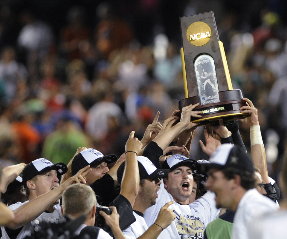 Photo - Vanderbilt players celebrate after Vanderbilt defeated Virginia 3-2 in Game 3 of the best-of-three NCAA baseball College World Series finals in Omaha, Neb., Wednesday, June 25, 2014. (AP Photo/Eric Francis)