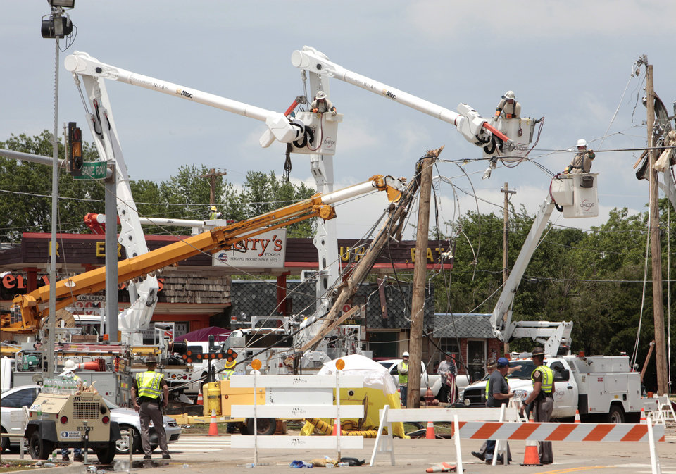 Utility crews work to restore power at Telephone Rd. and 12th Street in Moore from the May 20th tornado, Thursday, May 23, 2013.  Photo by David McDaniel, The Oklahoman