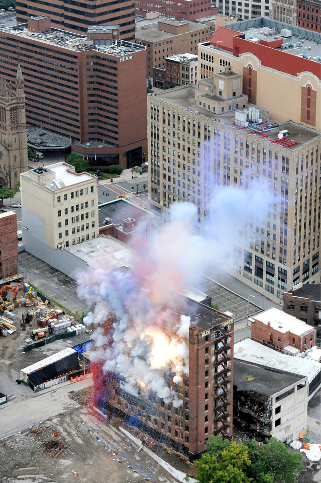 Photo - Explosives are set off inside the Wellington Annex during an implosion on Saturday, Aug. 23, 2014, in Albany, N.Y. The building was imploded to make way for Albany's new convention center. (AP Photo/Times Union, Cindy Schultz)