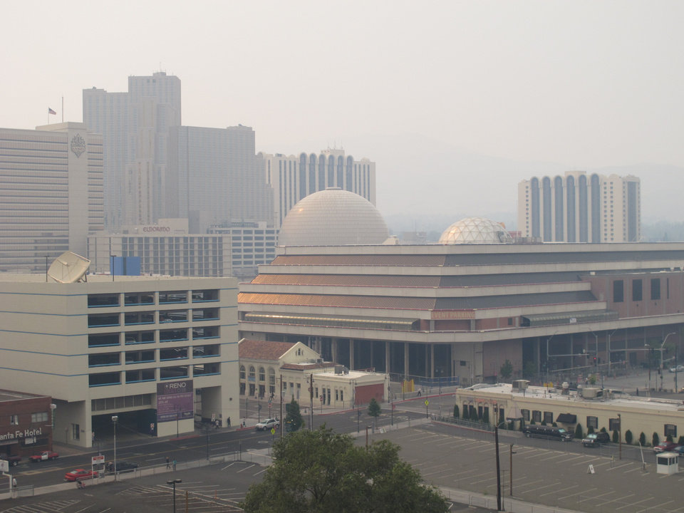 Hazy smoke from a wildfire more than 150 miles away near Yosemite National Park descended Thursday, Aug. 22, 2013, on Reno and the downtown casino district. Washoe County Health District officials issued an air quality alert because the Air Quality Index worsened to the unhealthy zone for sensitive groups, including the elderly and young children. (AP Photo/Scott Sonner)