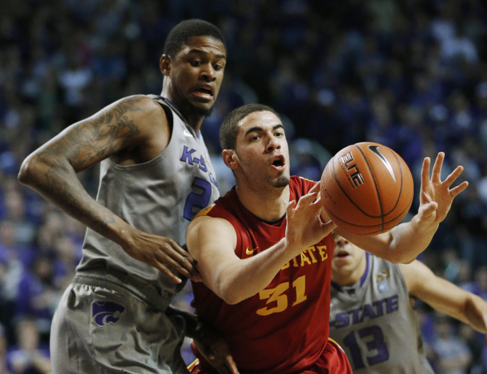 Iowa State forward Georges Niang (31) passes to a teammate while covered by Kansas State forward Jordan Henriquez (21) during the first half of an NCAA college basketball game in Manhattan, Kan., Saturday, Feb. 9, 2013. (AP Photo/Orlin Wagner)
