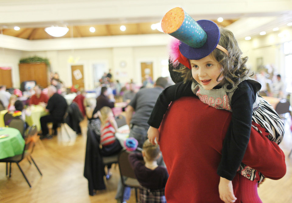 Photo - Craig Brown and his daughter, Maggie, 5, at the Daddy-Daughter Mad Hatter Tea Party in Edmond. PHOTO BY DOUG HOKE, THE OKLAHOMAN.  Doug Hoke - THE OKLAHOMAN