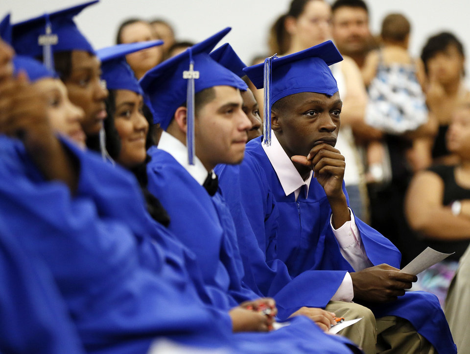 Photo - Graduates listen to Mayor Mick Cornett speak during the graduation ceremony for Emerson High School at the Oklahoma City campus of Langston University, Thursday, May 16, 2013. Emerson is an alternative education high school for students who need non-traditional learning because of a variety of reasons including teen pregnancy, homelessness and a need to work to support family.  Photo by Nate Billings, The Oklahoman