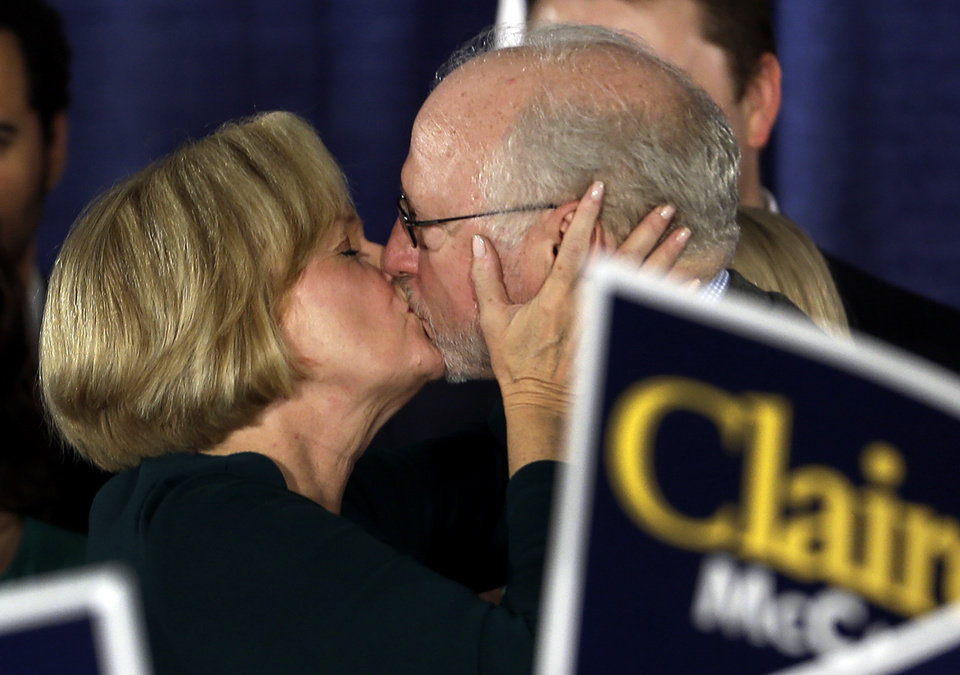 Photo -   Sen. Claire McCaskill, D-Mo., left, kisses her husband, Joseph Shepard, after declaring victory over challenger Rep. Todd Akin, R-Mo., in the Missouri Senate race Tuesday, Nov. 6, 2012, in St. Louis. (AP Photo/Jeff Roberson)