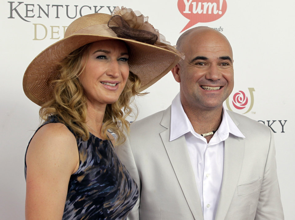 Former tennis players Steffi Graf and her husband Andre Agassi arrive for the 138th Kentucky Derby horse race at Churchill Downs Saturday, May 5, 2012, in Louisville, Ky. (AP Photo/Darron Cummings)  ORG XMIT: DBY134