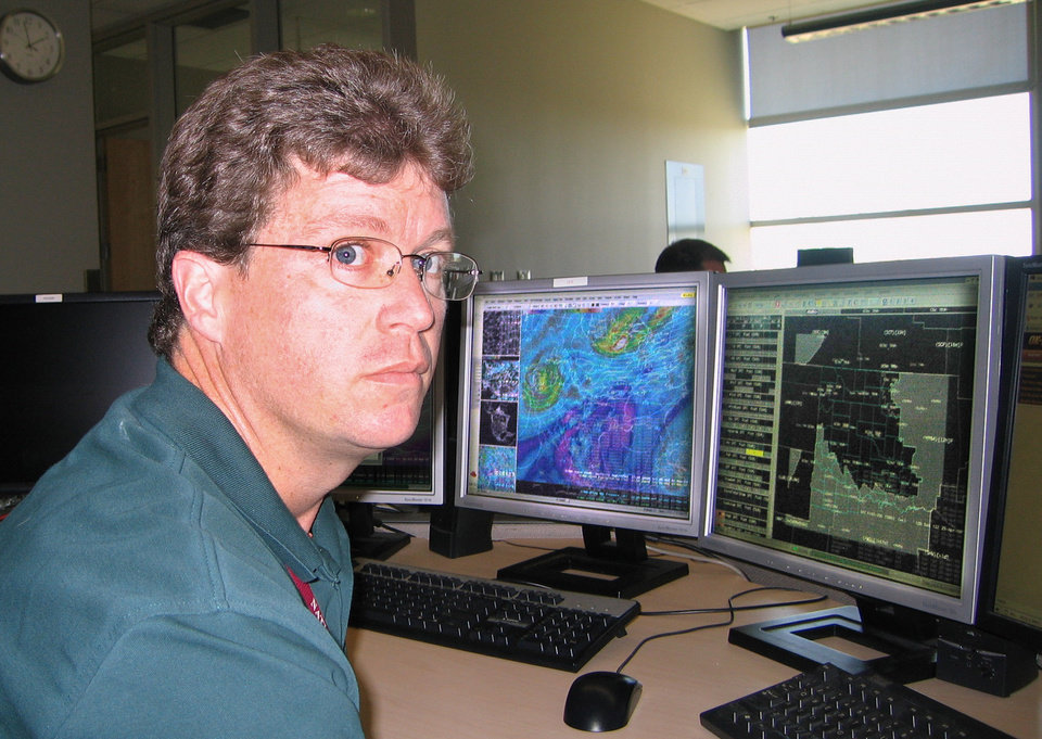 Photo - Scott Curl, meteorologist, National Weather Service Norman forecast office, at the National Weather Center in Norman Tuesday, April 21, 2009. Curl recently talked about technology regarding the May 3, 1999 tornadoes. Photo by Bryan Painter, The Oklahoman ORG XMIT: KOD