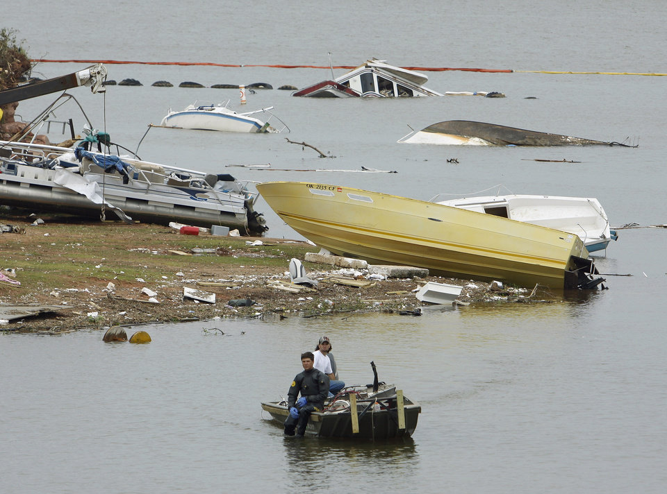 A salvage diver moves into position to recover boats and debris at Lake Thunderbird on Wednesday, May 12, 2010, in Norman, Okla.   Photo by Steve Sisney, The Oklahoman